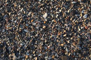 Ground texture beach wet rocks colorful smooth stones wallpaper