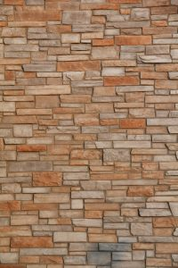 Stone Texture flag stone brik red wall surface stock photo