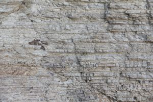 Stone texture rock wall rough surface layered wallpoaper stock