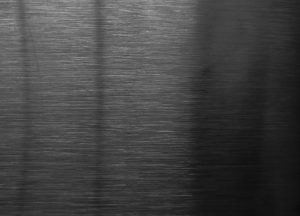 brushed steal metal texture dark steel wall photo cold black