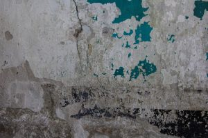 grunge texture old wall beat up dirty grime cracked layered stock photo