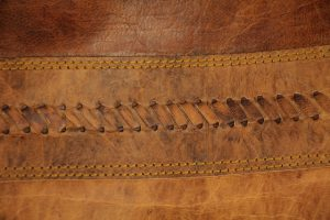 leather texture multi colored brown light dark thick stitched fabric material