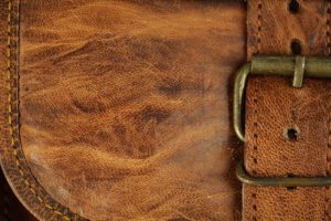 leather texture stitched bag brass buckle stock photo