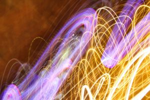 light texture yellow purple streaking moving lines wavy pattern image