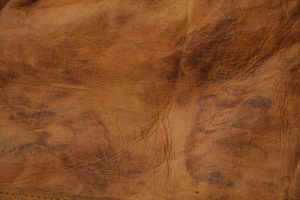 rough leather texture folded wrinkled brown pattern stock photo
