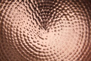 shiney copper metal texture pitted bowl water drop wallpaper