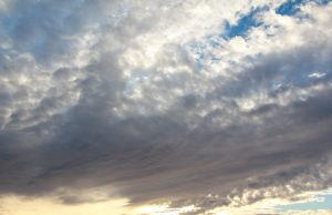 sky texture fluffy clouds sunset glow white blue yellow photo