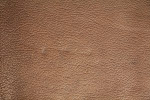 tan leather texture dented patterned material soft book cover wallpaper