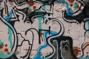assorted spray painted colors on large wall graffiti