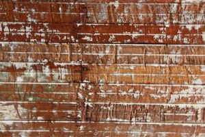 brick photo with white splash on top of red