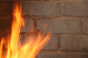 gray brick wall focus on strong fire